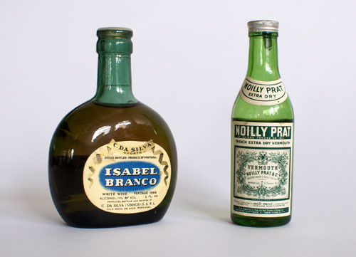 Noilly Prat and Isabel Branco, vintage liquor bottles that might best you in a showdown.