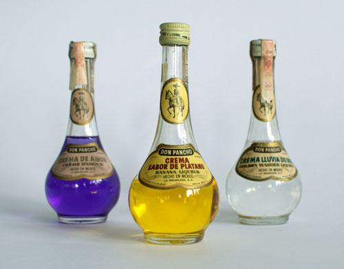 Three bottles of Liqueur: Crema de Amor, Crema Sabor de Platano and Crema Lluvia de Oro.