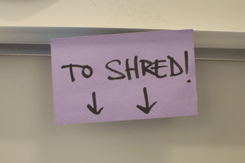"Purple sticky note that says ""to Shred""."