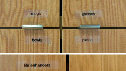 Kitchen cupboard labels: mugs, glasses, bowls, plates, life enhancers. All in a days work at Ziba.