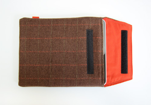 Brown and orange plaid iPad case with orange dotted lining.