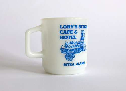 Lory's Sitka Cafe and Hotel - milk white mug with blue screen printing of a sandwich and drink.