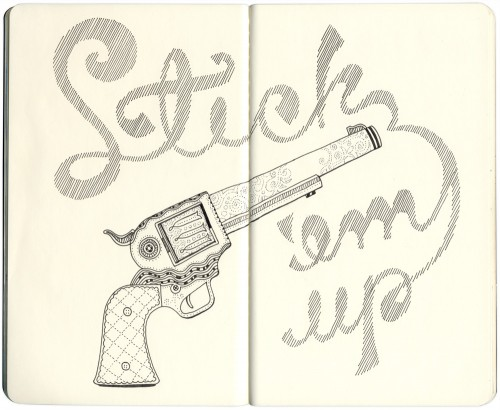 embroidered gun with shaded type