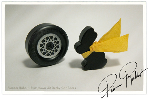 My pioneer rabbit poses in his jaunty yellow crepe paper scarf next to his custom rims.
