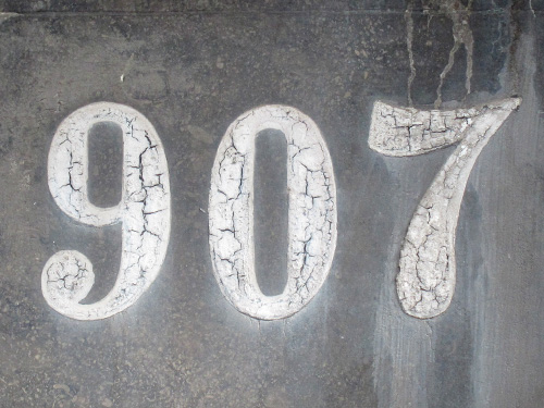 Old painted on house numbers in Amsterdam.