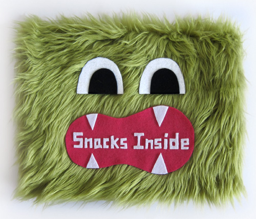Goodie Monster vending machine sign made out of green faux fur and a hungry monster mouth.