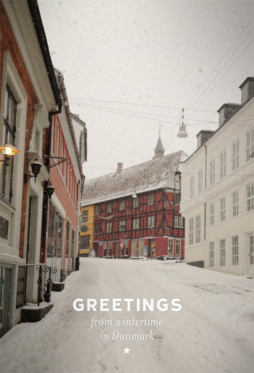 A wintry scene from Fyn Denmark during the month of December. A deserted walking street the day before Christmas with old buildings and street lamps.