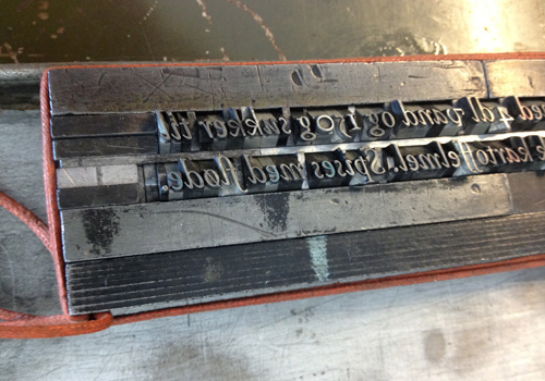 Block of metal type - the recipe for our rød grød poster.