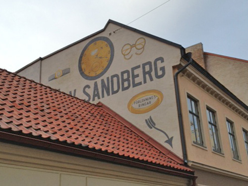 Painted advertising on a building facade in Malmø, Sweden.