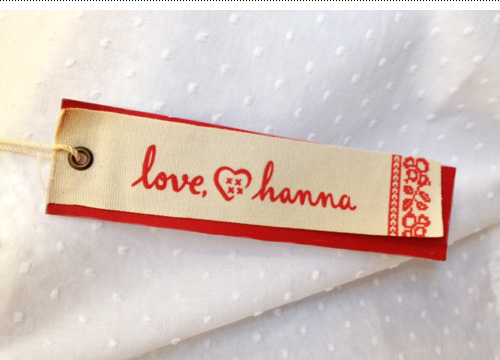 Love, Hanna logo used on the hangtag of the women's  clothing line.