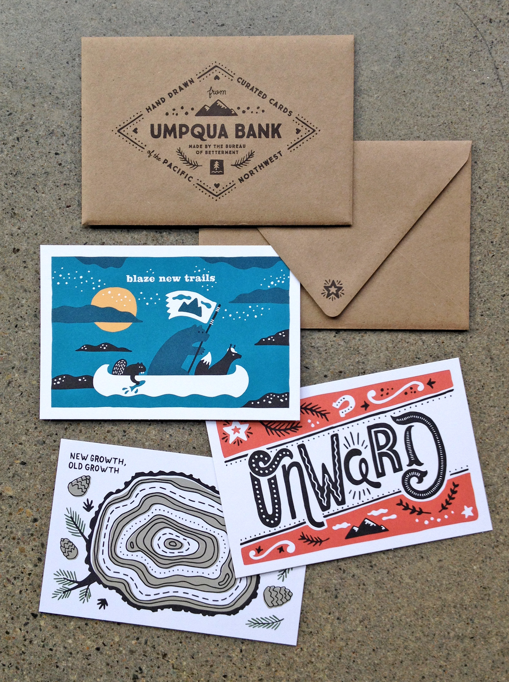 set of three postcards and envelope for Umpqua Bank - blaze new trails, onward, and old growth new growth