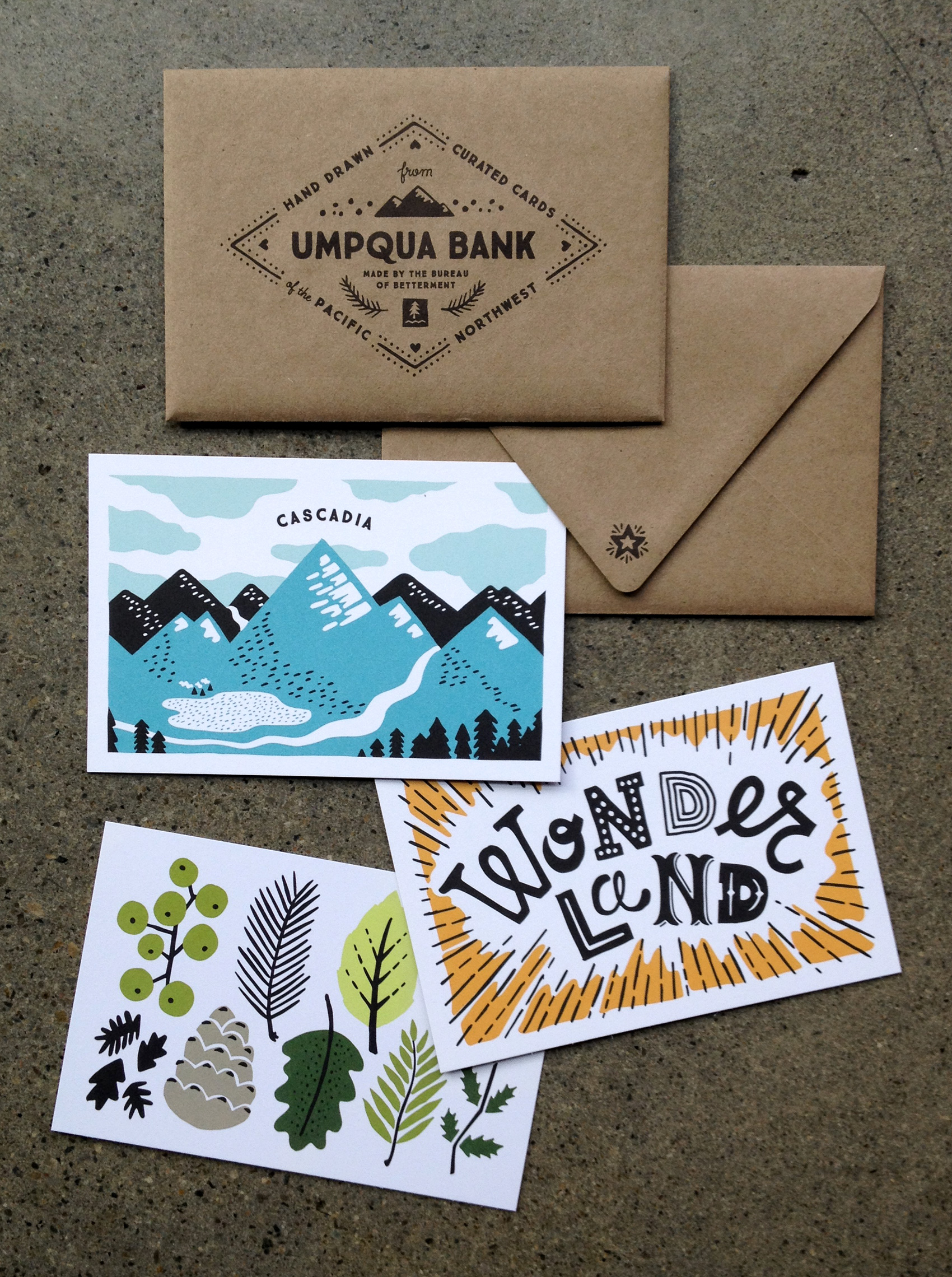 Northwest inspired hand drawn illustrations for Umpqua Bank. Three postcards including Cascadia mountain range, Wonderland typography, and Oregon foliage.