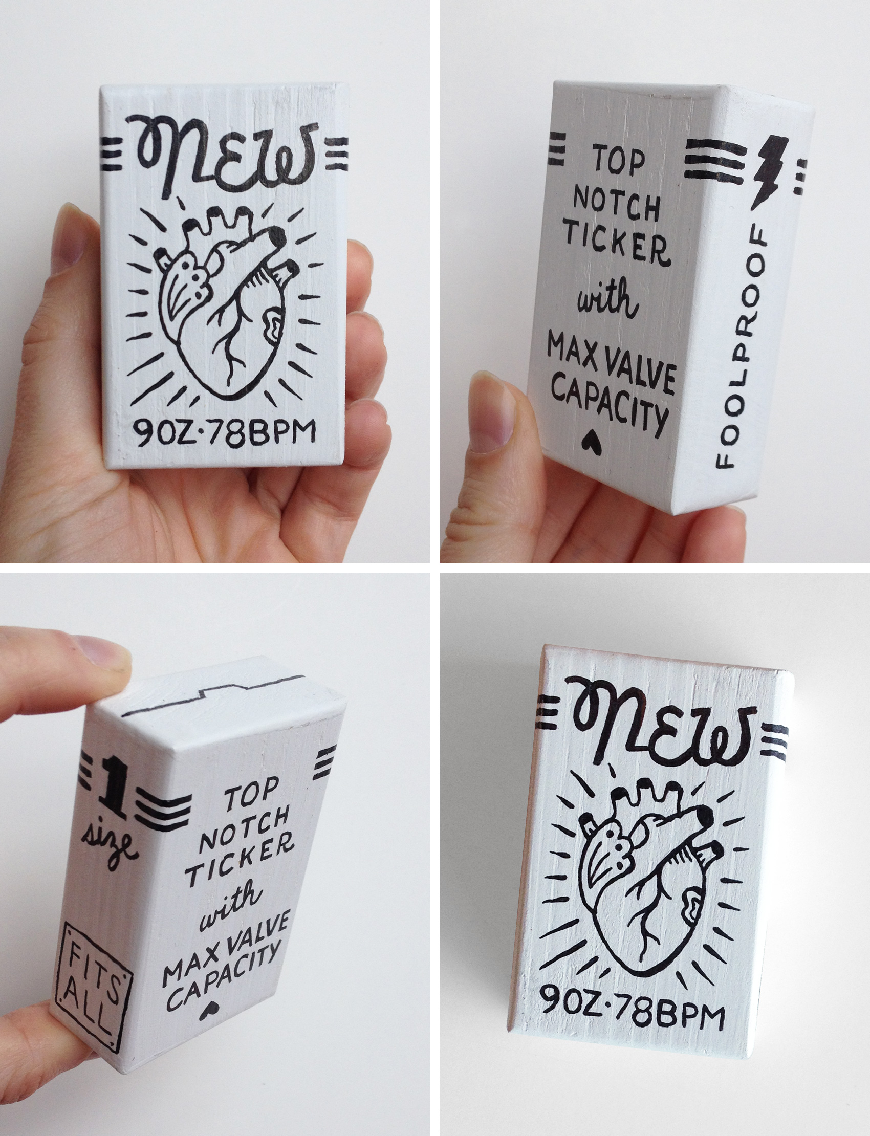 """White and black handpainted box with lettering and illustration for a """"New Heart"""" inspired by the 69 Love Songs Magnetic Fields song """"I think I need a new heart."""""""