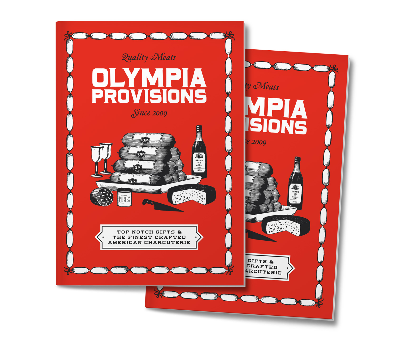 Olympia Provisions holiday catalog - a red booklet with stack of sausage on display