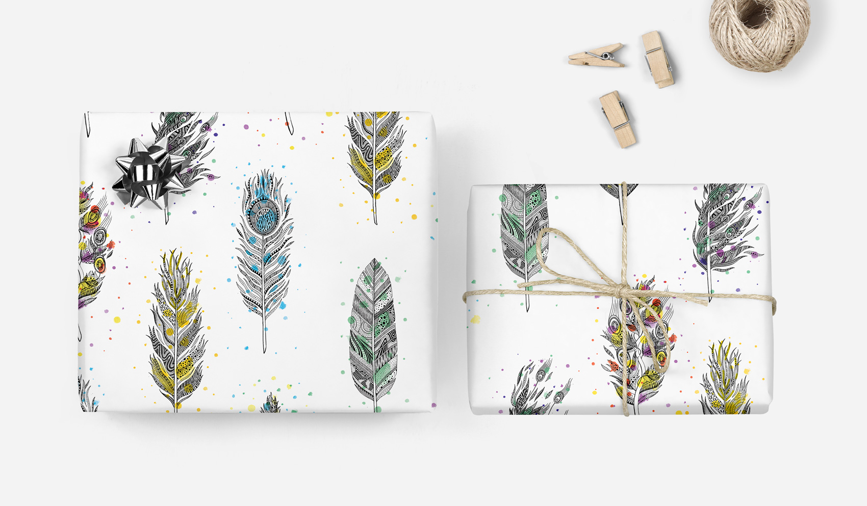Illustrated feather pattern gift wrap with watercolor specs.
