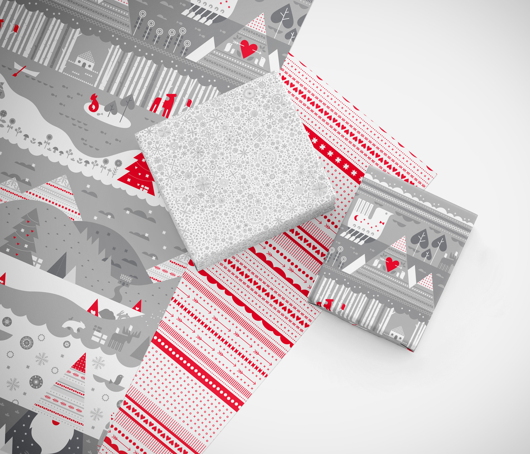 Red ribbon and silver snowflake flurry gift wrap paper patterns, along with gnome winter landscape in tonal grays.