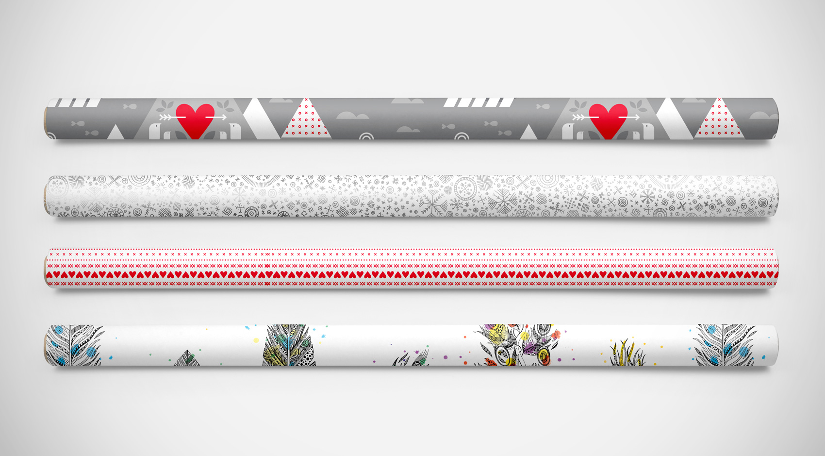 Four rolls of West Coast Paper and Brown Printing collaboration on holiday promotional gift wrap.